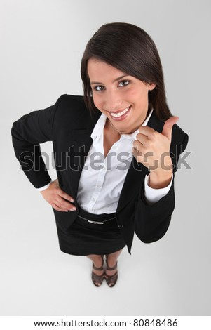 Businesswoman with thumbs up - stock photo