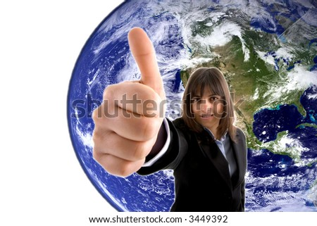 Businesswoman with thumbs up agains globe - stock photo