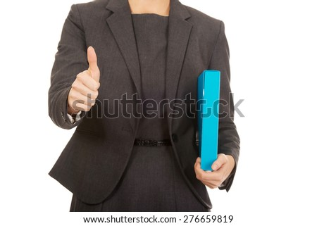 Businesswoman with thumbs up holding a binder. - stock photo