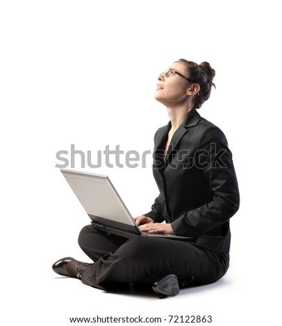 Businesswoman with tired expression using a laptop