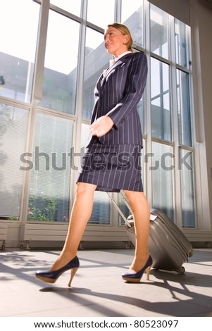 businesswoman with trolley