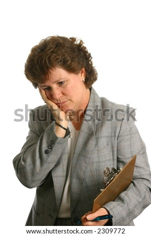 Businesswoman with worried or depressed expression - stock photo