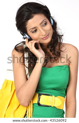 Businesswoman with yellow hand bag talking over cellphone