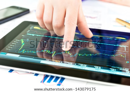 Businesswoman work with documents and tablet computer - stock photo