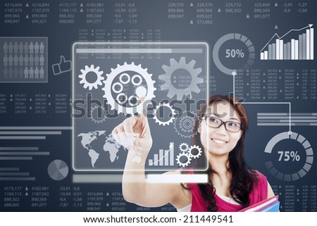 Businesswoman work with gear in a virtual system - stock photo