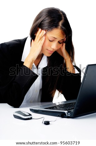 businesswoman working at her desk with laptop computer is stressed, frustrated and overwhelmed by depressing business situations. isolated on white - stock photo