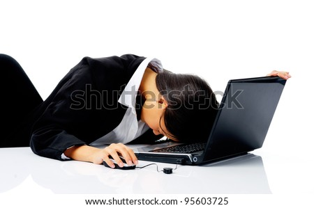 businesswoman working at her desk with laptop computer is stressed, frustrated and overwhelmed by depression business situations. isolated on white - stock photo