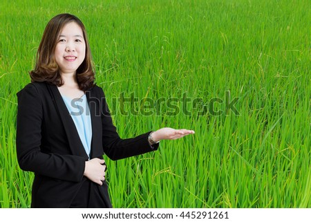 Businesswoman working at her office by herself on Rice background - stock photo