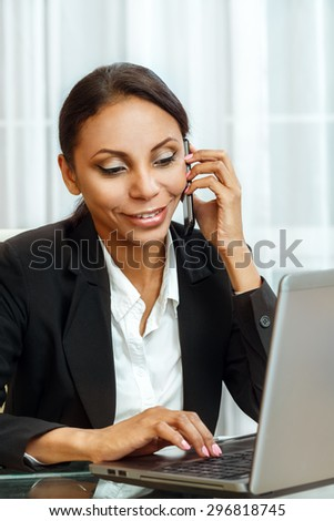 Businesswoman working at the desk - stock photo
