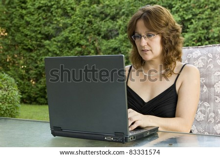Businesswoman working from home - stock photo