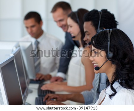 Businesswoman working in a call center with her international team - stock photo