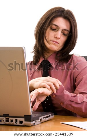 businesswoman working late at the office, looking at the time - stock photo