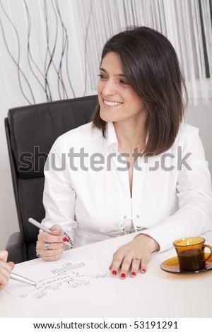 Businesswoman working on a firewall schema (selective focus) - stock photo