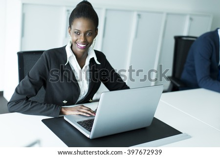 Businesswoman working on a laptop at the office