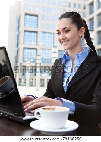 businesswoman working on coffee break, outdoor - stock photo