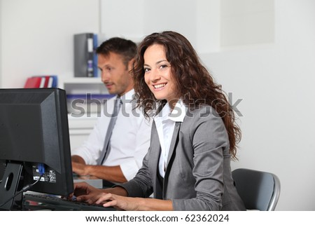 Businesswoman working on computer - stock photo
