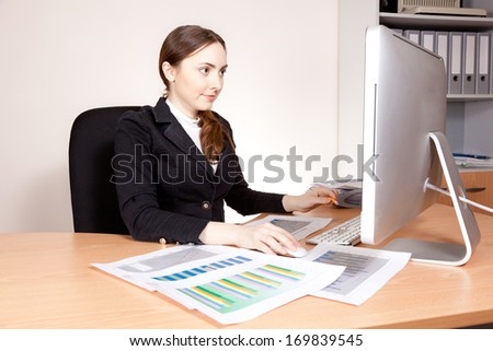 Businesswoman working on her computer at office
