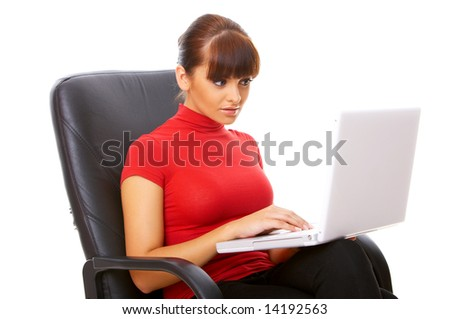 Businesswoman working on her laptop while sitting on chair