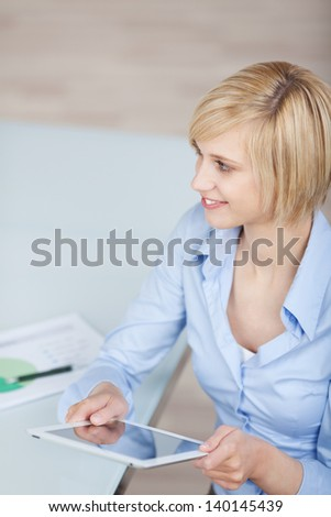 businesswoman working on tablet-pc in the office - stock photo