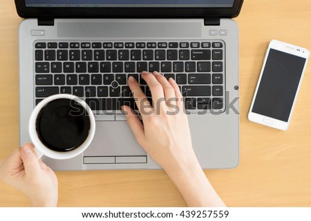 Businesswoman Working Using Laptop and mobile phone