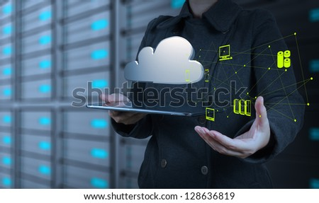Businesswoman working with a Cloud Computing diagram on the new computer interface - stock photo