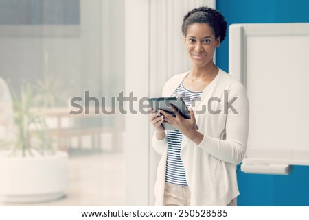 Businesswoman working with a tablet in offfice
