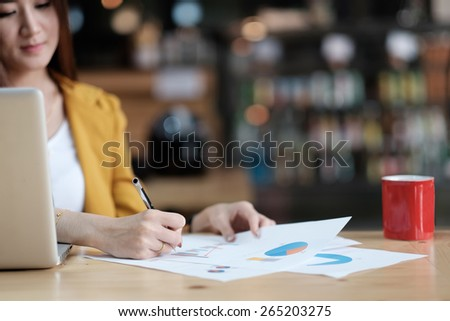 businesswoman working with document and laptop - stock photo
