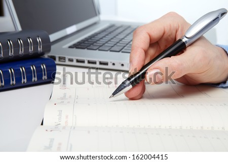 Businesswoman working with documents in the office