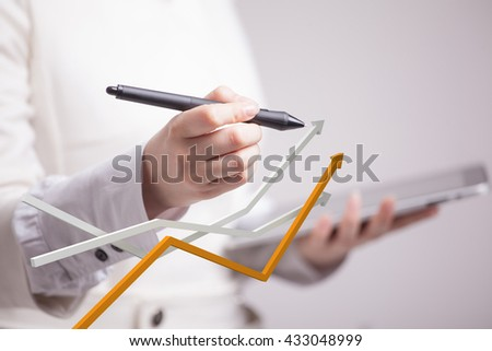 Businesswoman working with growth graph on grey background - stock photo