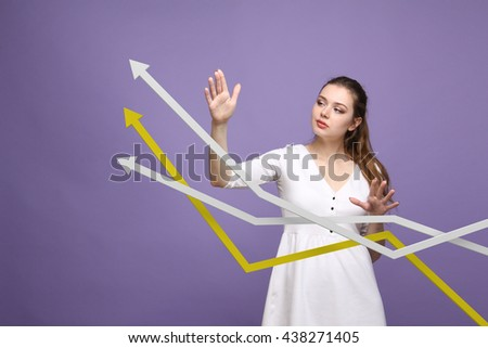 Businesswoman working with growth graph on violet background - stock photo