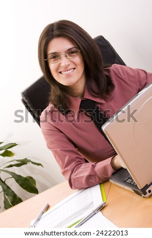 businesswoman working with her laptop at the office