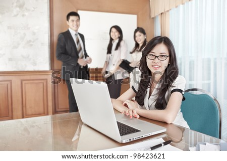 Businesswoman working with laptop in the office - stock photo