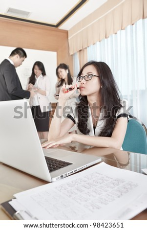 Businesswoman working with laptop in the office