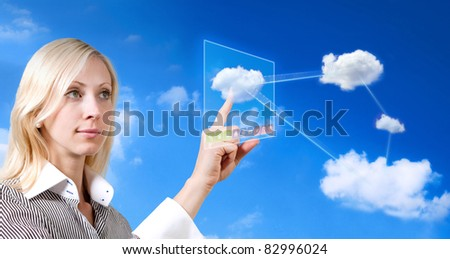 businesswoman works with cloud computer - stock photo