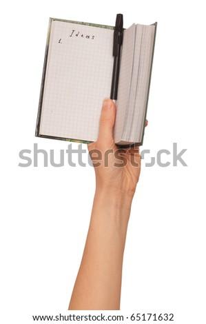 businesswoman writes ideas for a business plan - stock photo
