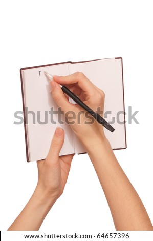 businesswoman writes notes for a business plan - stock photo