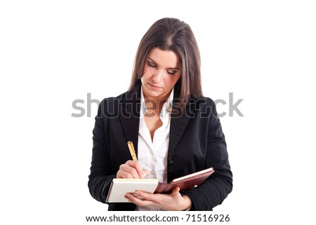 Businesswoman writing on her agenda, isolated over white - stock photo