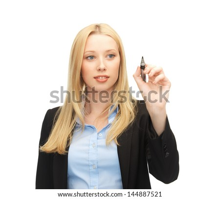 businesswoman writing something in the air with marker