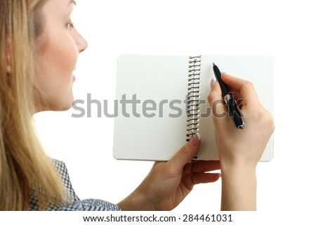 Businesswoman writing with pen - stock photo