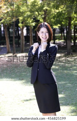 Businesswoman you are in the park - stock photo