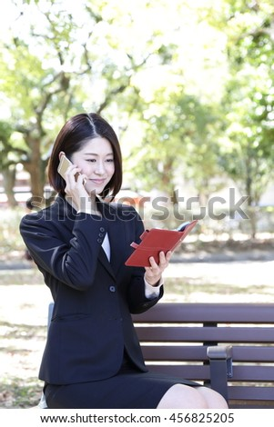 Businesswoman you are in the park