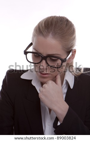 Businesswoman. Young businesswoman wearing black framed glasses on a white background.