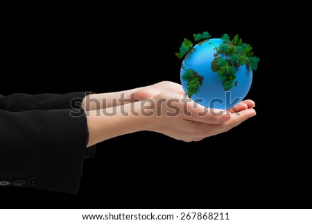 Businesswomans hands presenting against earth with forest