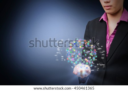 Businesswomans holding hand out against blue background - stock photo