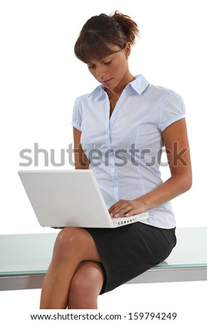 Businesswomanusing her laptop