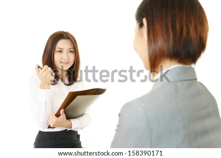 Businesswomen discussing plans - stock photo
