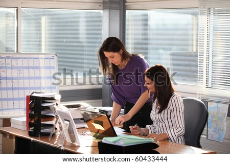 Businesswomen in office - stock photo