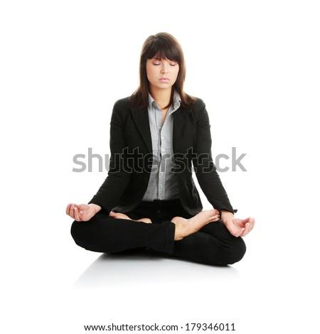Businesswomen meditating in lotus position.  - stock photo