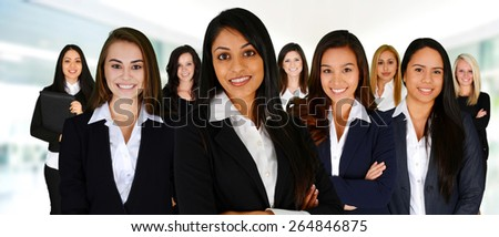 Businesswomen of all races working together in an office