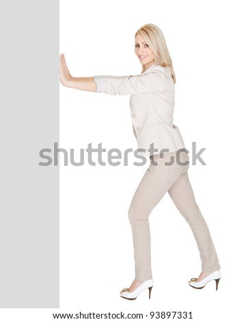Businesswomen pushing a copyspace. Isolated on white - stock photo